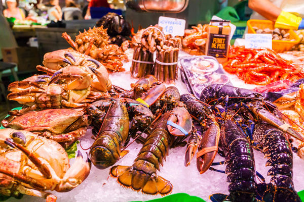 Countertop With Various fresh seafood at La Boqueria market Barcelona 77220826